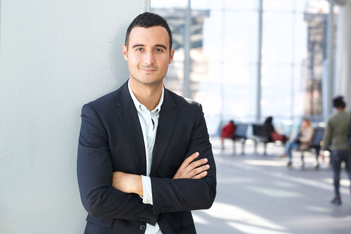 Portrait of businessman posing with arms crossed